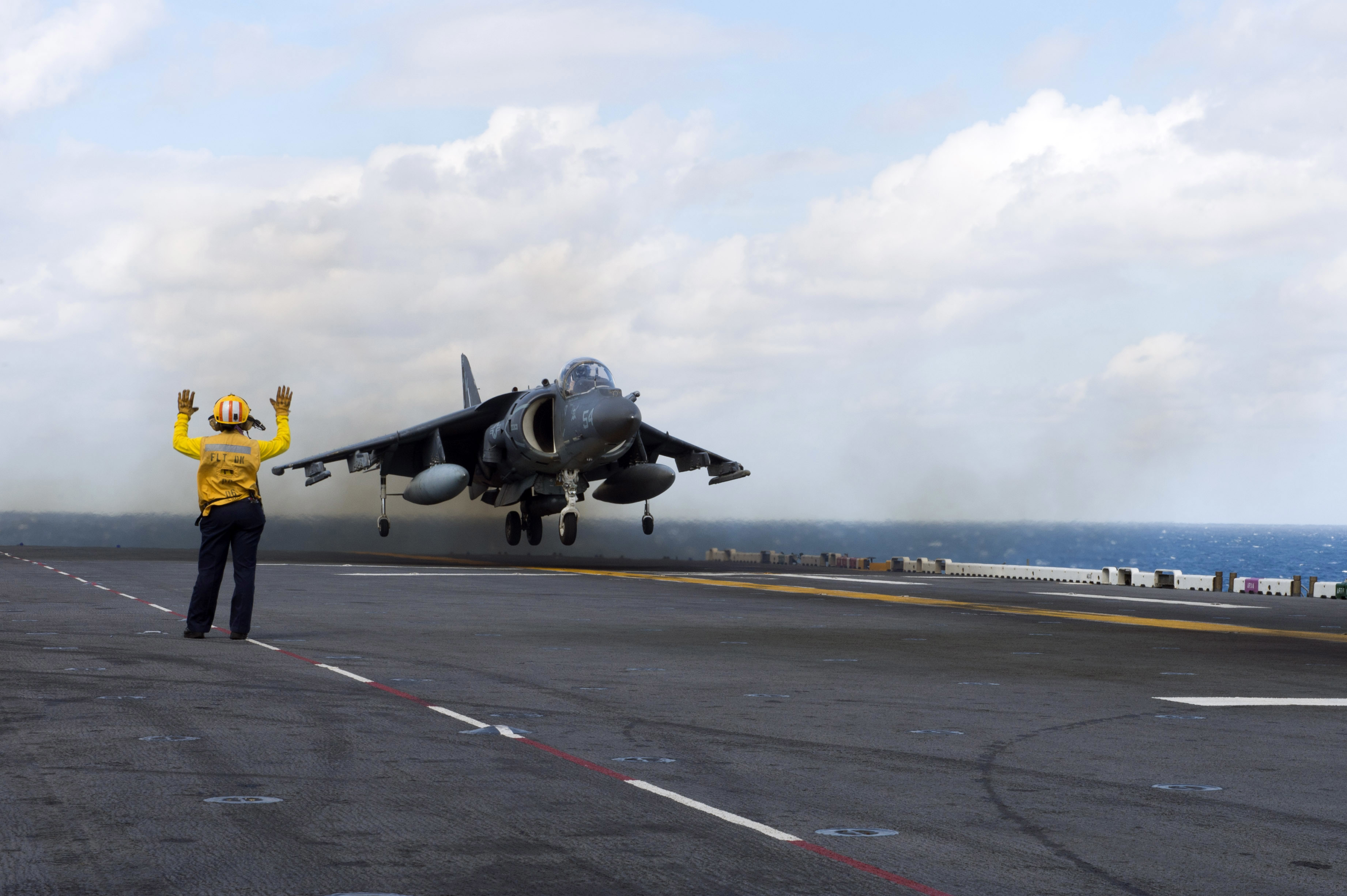 Composite Training Unit Exercise 141014-N-KD168-033.jpg English: An AV-8B Harrier II lands on the flight deck of Wasp-class amphibious assault