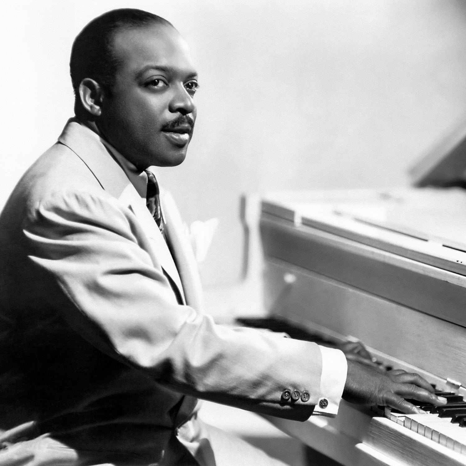 Basie at the piano, 1955, in a photographic portrait by [[James J. Kriegsmann]]