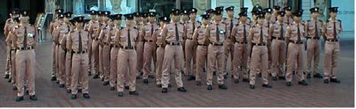 A Group Of Hong Kong Security Guards In Formation Before Going On Duty