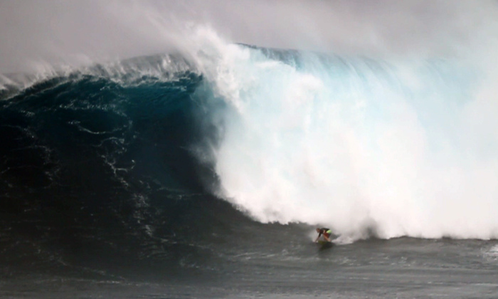 File:Jeff Rowley Big Wave Surfer Bottom turn Photo Jaws Peahi by Xvolution Media - Flickr - Jeff Rowley Big Wave Surfer.jpg