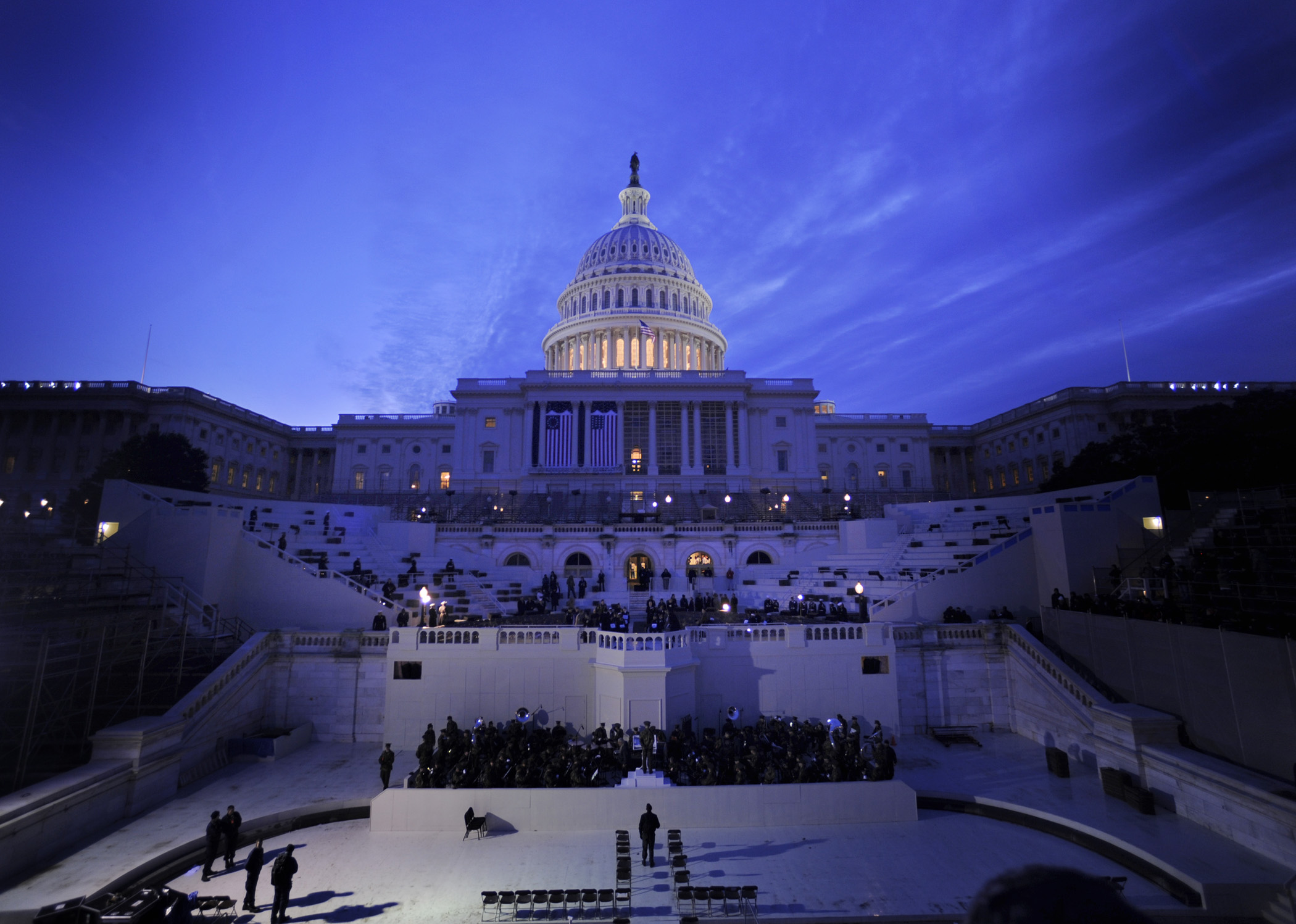 U.S. Capitol at dusk, mostly darkened but with dome floodlit from within