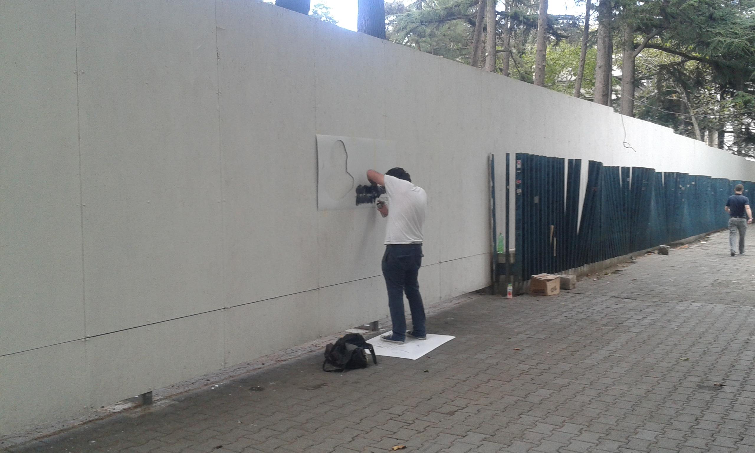 Composite Image Of Stencil Graffiti >> File Tbilisi Georgia Georgian Artist Making A Stencil Graffiti On