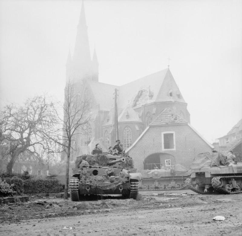 "A Cromwell tank of the ""Skins"" with Kangaroo APCs of the 9th DLI, in front of the church of St. Ludgerus"