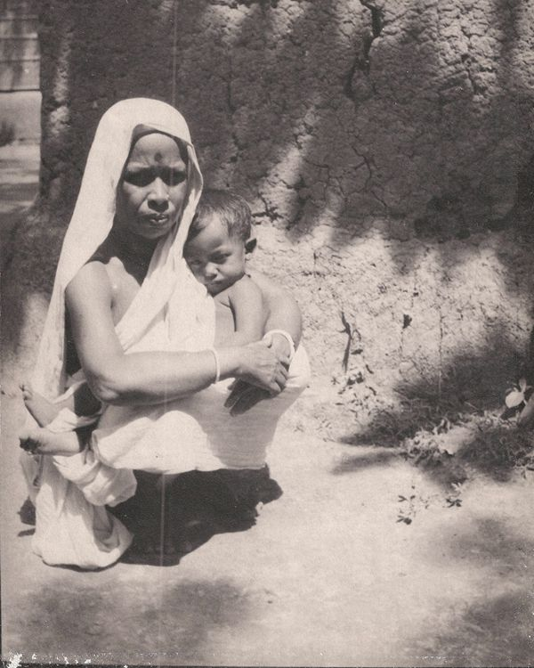 FileWoman In White Sari Carrying A Child