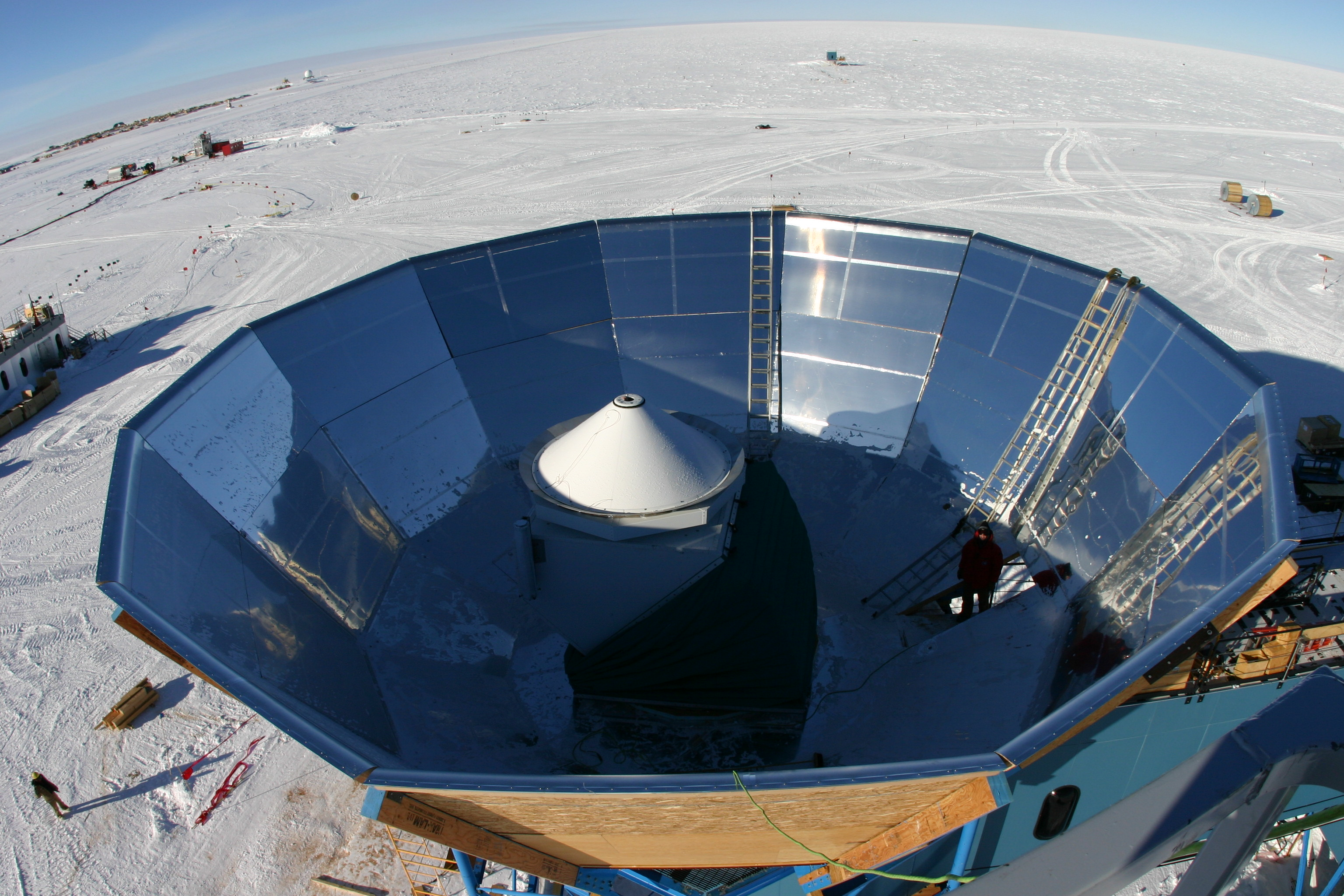 A photograph of the QUaD telescope inside its groundshield taken from a crane above the telescope.