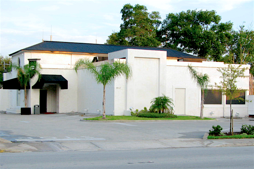 Exterior photo of Pulse gay nightclub and parking lot.