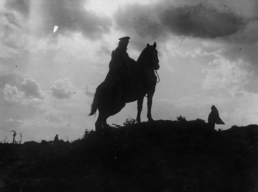 A_cavalryman_sitting_on_his_horse_on_a_ridge._Man_and_horse_are_black%2C_outlined_against_a_cloudy_sky._This_photograph_is_symbolic_of_the_last_days_of_the_use_of_cavalry_in_European_warfare._Trench_%284687939107%29.jpg