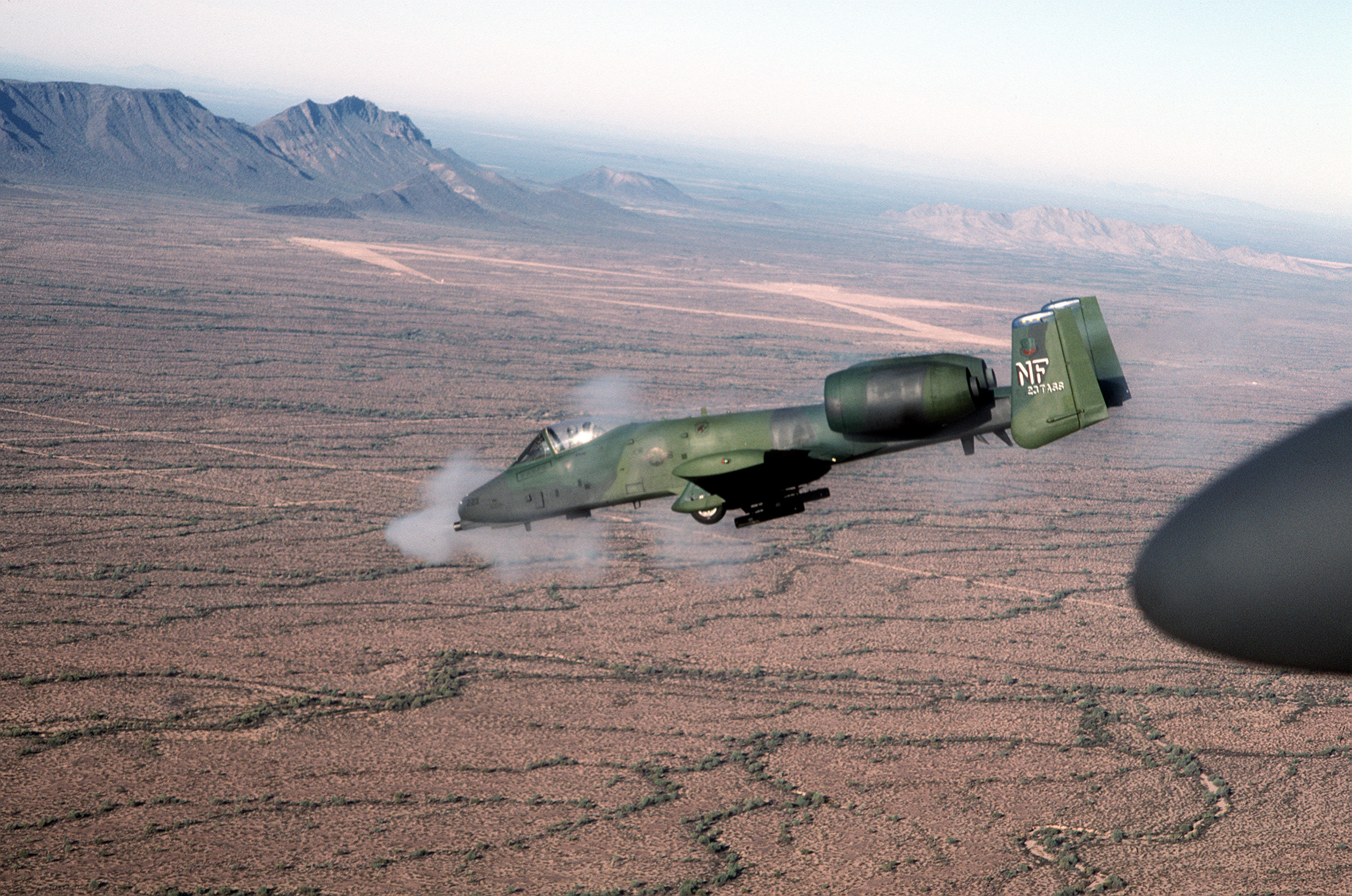 An Air To Left Side View Of OA 10 Thunderbolt II Aircraft The 23rd Tactical Support Squadron Firing Its GAU 8 A Avenger 30mm Cannon At