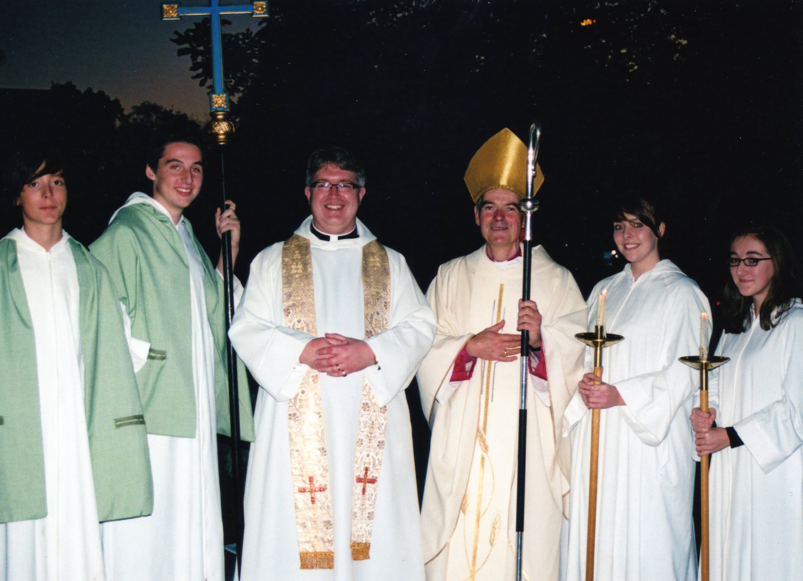 Two priests flanked by two pair of acolytes