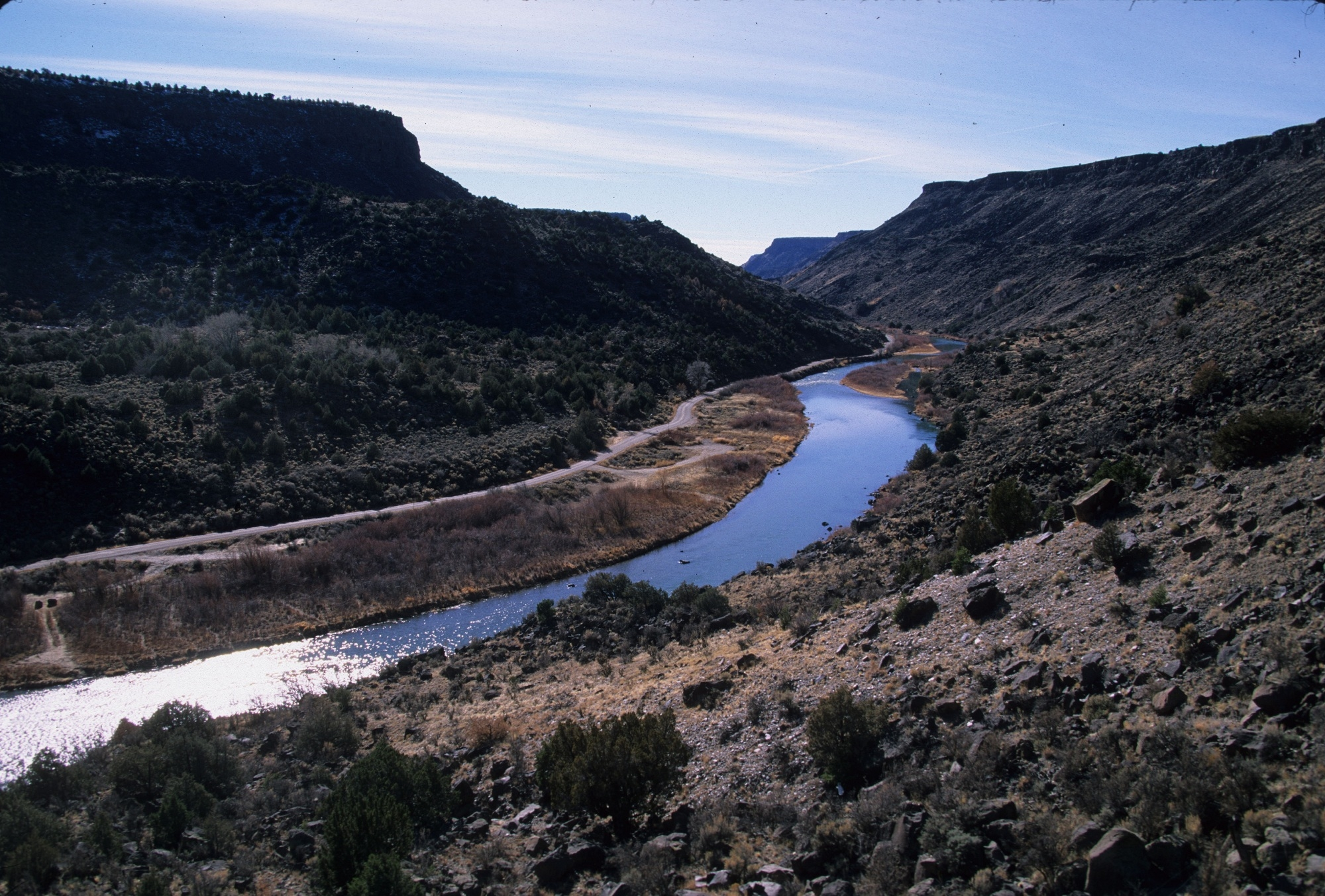 Arid desert plateaus flank the Rio Chama river in New Mexico