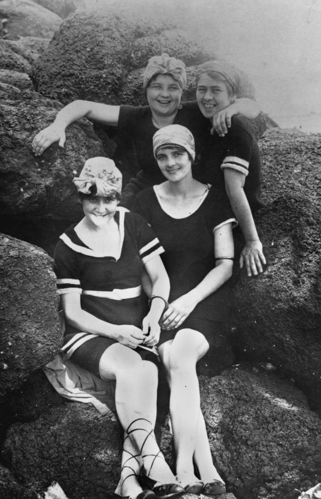 Group of women posing in their swimming costumes on the rocks. Image via Wikimedia Commons