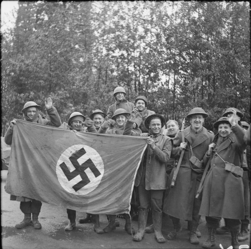 British soldiers demonstrating a Nazi flag