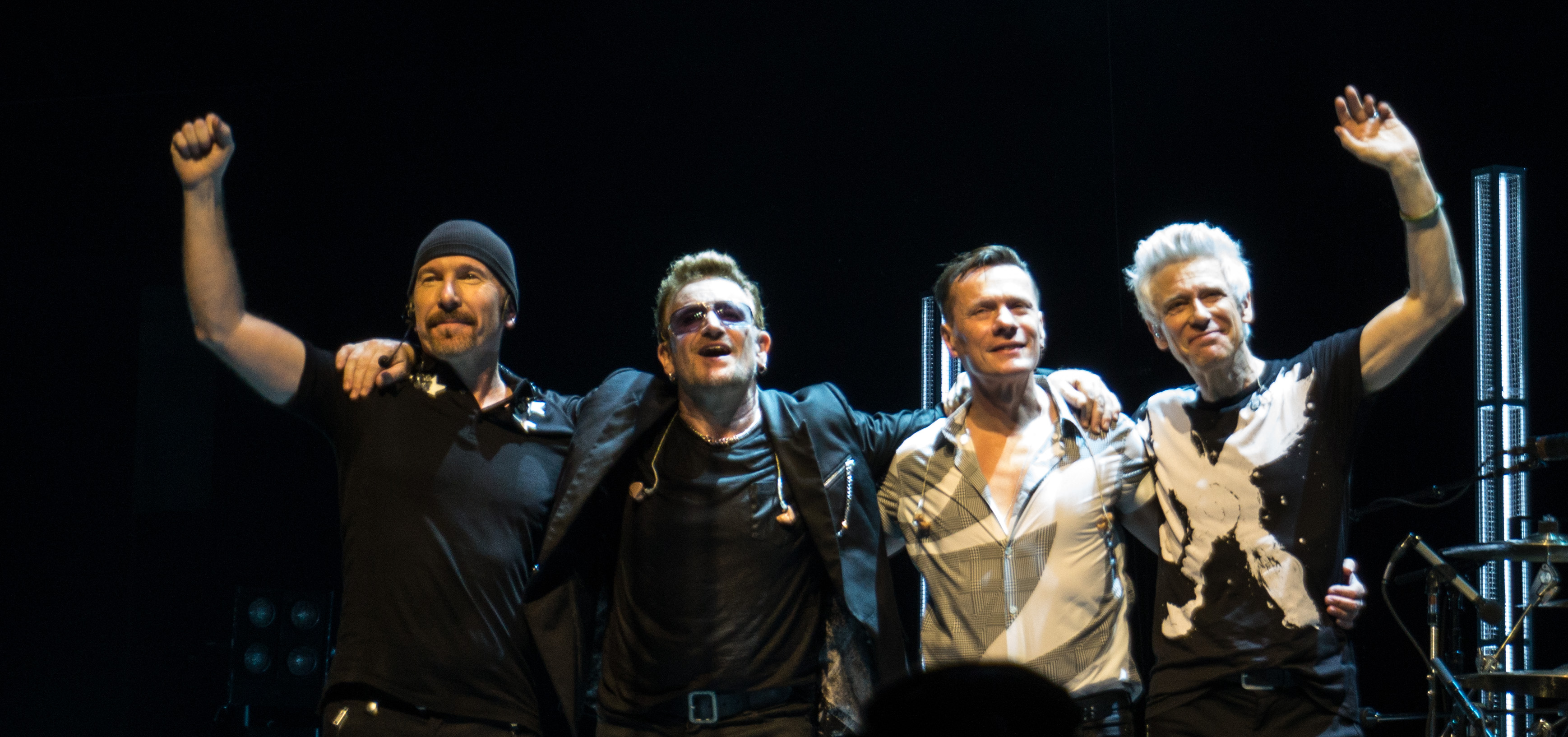 U2 takes a curtain call during a 7 November 2015 performance on the Innocence + Experience Tour (from left to right): the Edge, Bono, Mullen, Clayton