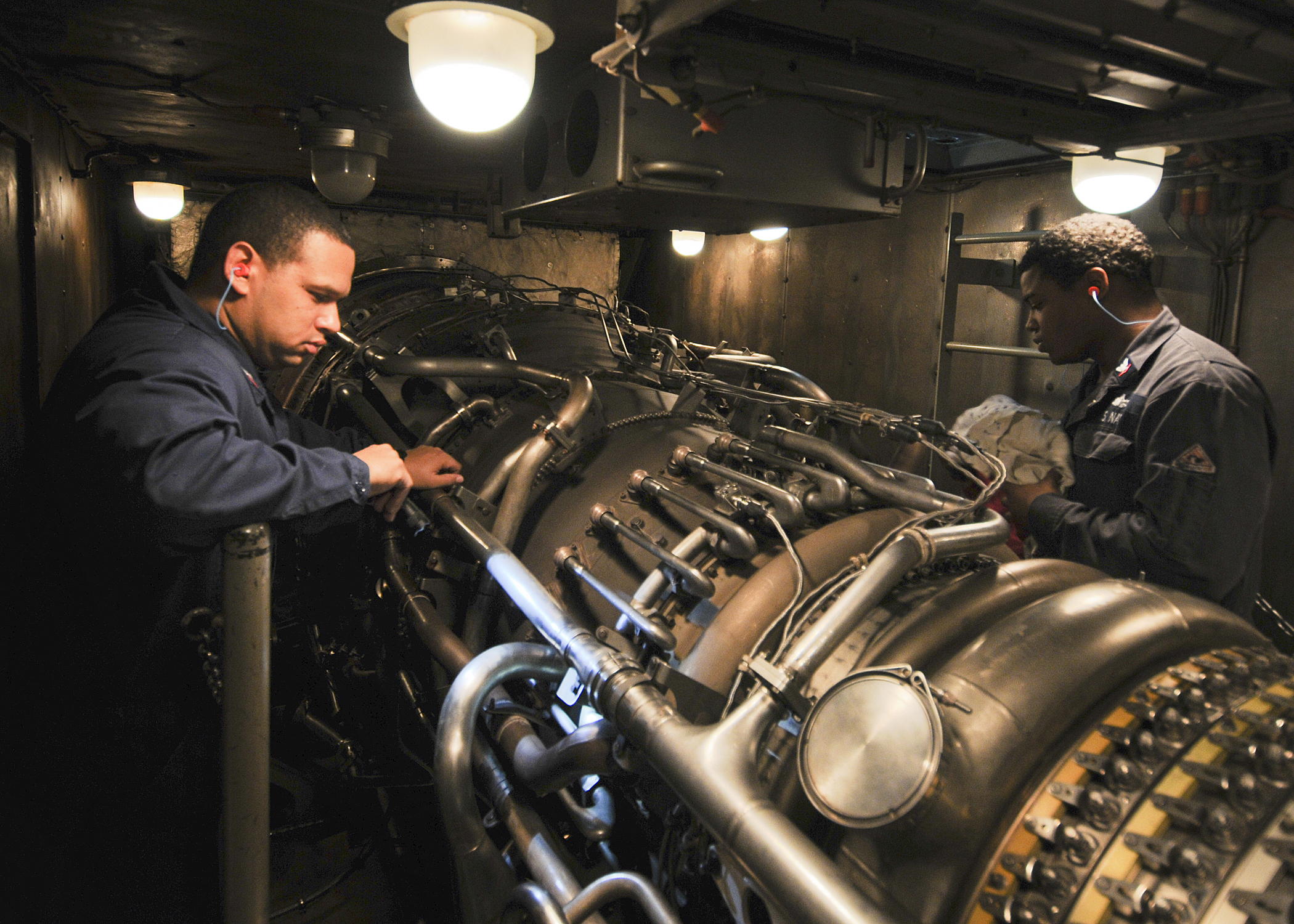 File US Navy N 9793B 015 Sailors check a gas turbine engine