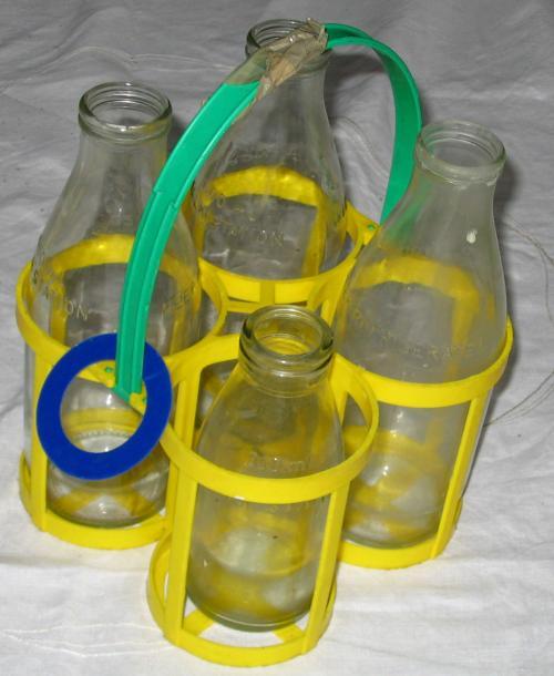 eturningreusableglassmilkbottles,usedforhomedeliveryserviceinthe