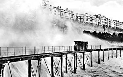 Volk's Electric Railway, c. 1890. Opened in 1883, it is the world's oldest operating electric tramway. Volk's Railway in Brighton braves stormy seas east of Banjo Grove.jpg