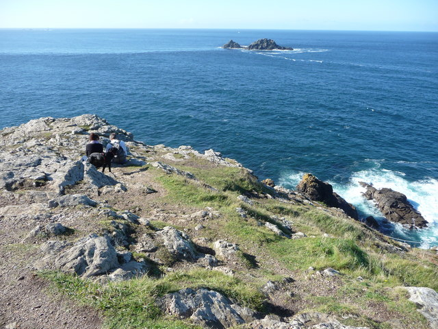 Walkers sit on Cape Cornwall - geograph.org.uk - 2106196