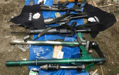 Weapons and other paraphernalia allegedly owned by members of the Mauten group; confiscated by the Philippine Army in July 2018 Maute confiscated weapons.jpg