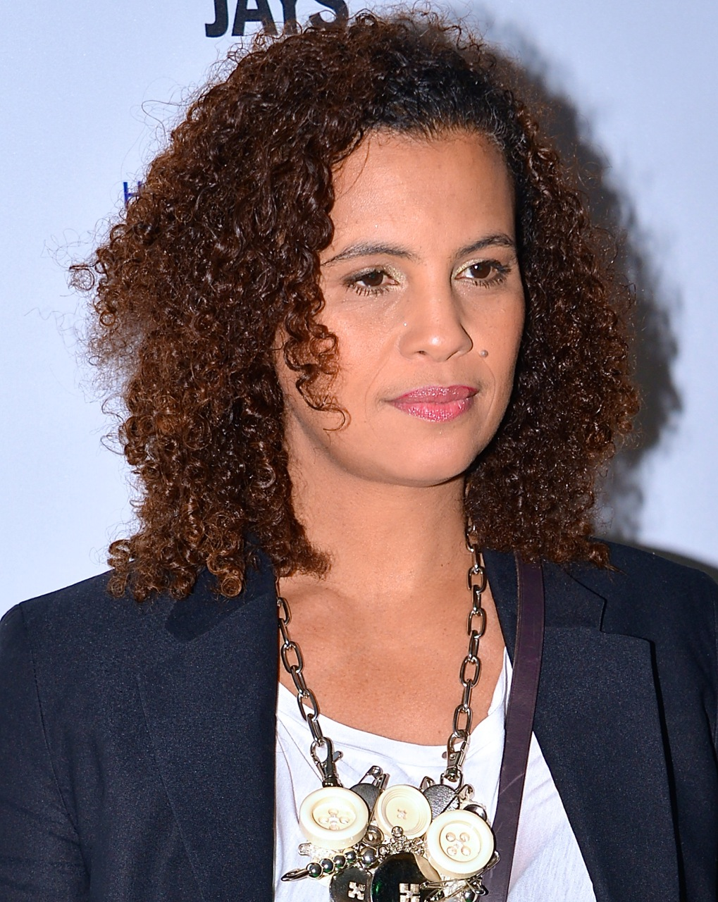 The 53-year old daughter of father (?) and mother(?), 173 cm tall Neneh Cherry in 2017 photo