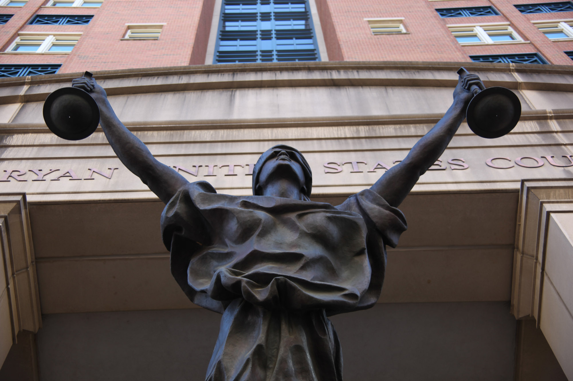Photograph of the statue outside Albert V Bryan Federal District Courthouse in Alexandria, Virginia.