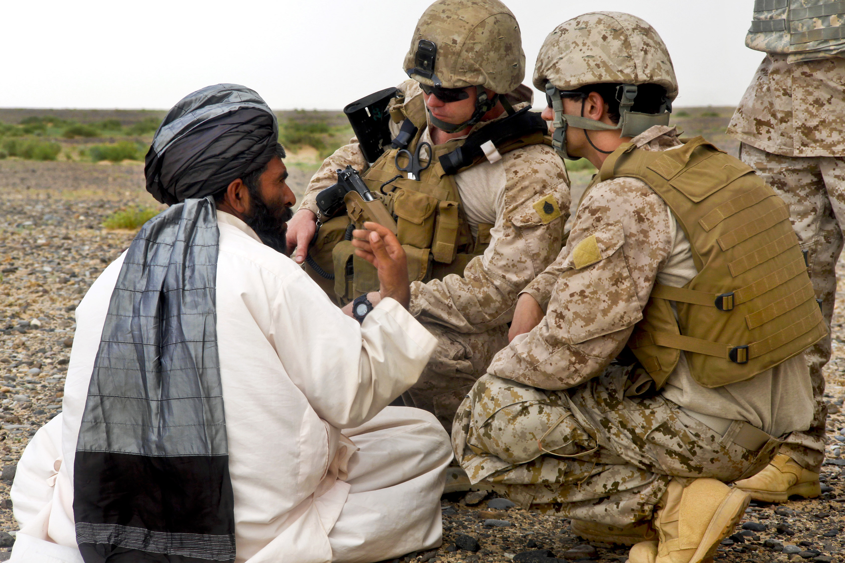 Defense.gov News Photo 110505-M-AN675-007 - U.S. Marines talk with an Afghan civilian during an aerial interdiction mission in southwestern Afghanistan on May 4 2011. The Marines are.jpg