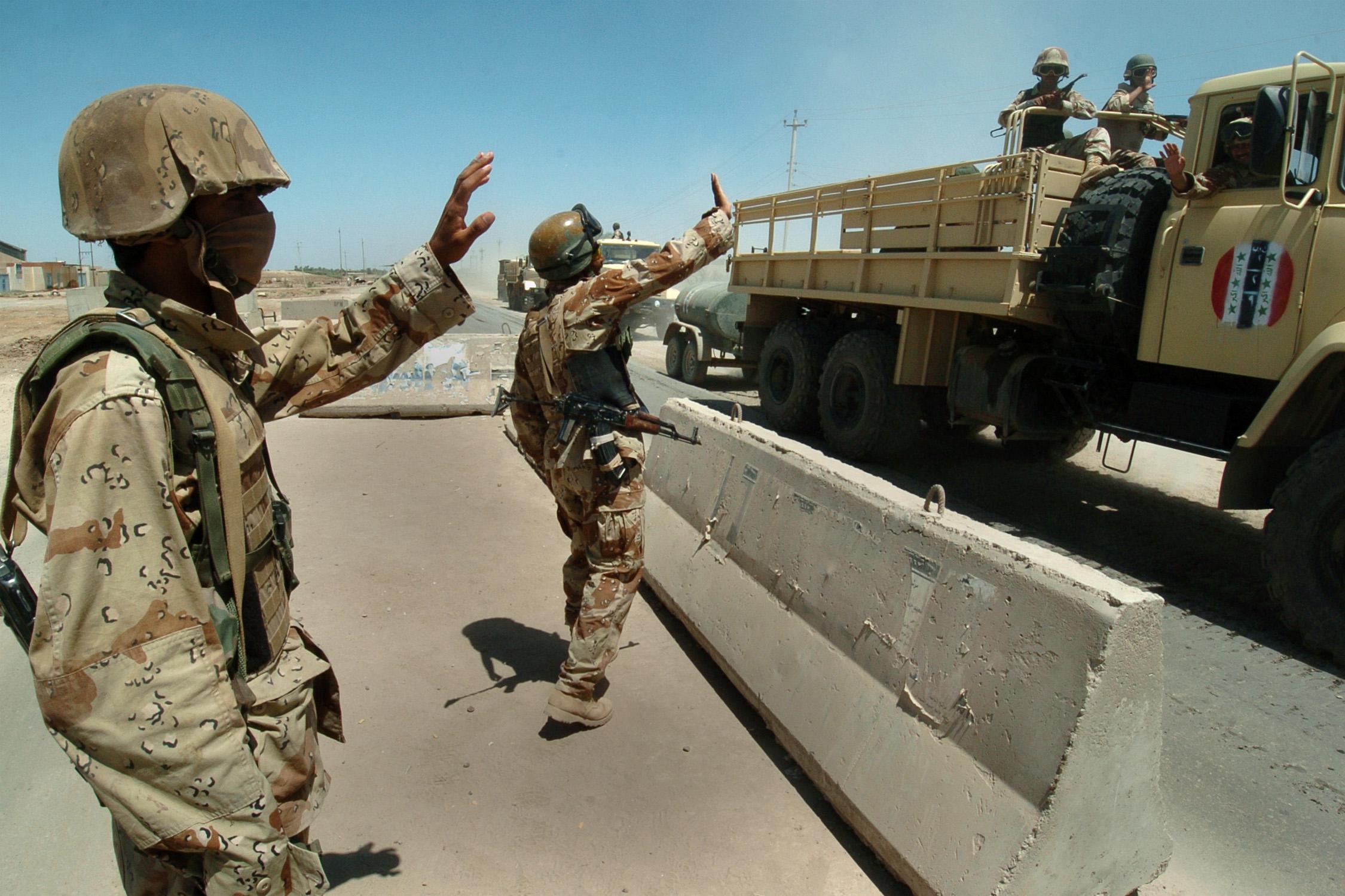 File:Iraqi KrAZ-6322 trucks passing through the highway checkpoint ...