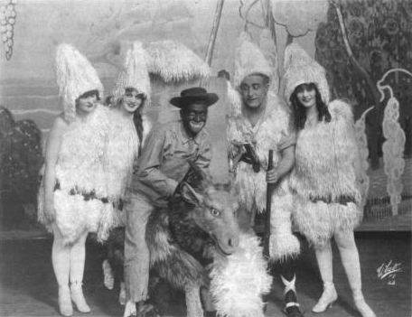 Al Jolson (in blackface) and other cast members of the stage musical Robinson Crusoe, Jr.