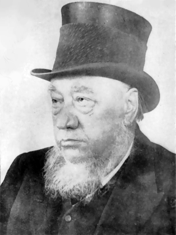 Paul Kruger as an old man with a grey beard wearing a black top hat as well as pirate style earrings