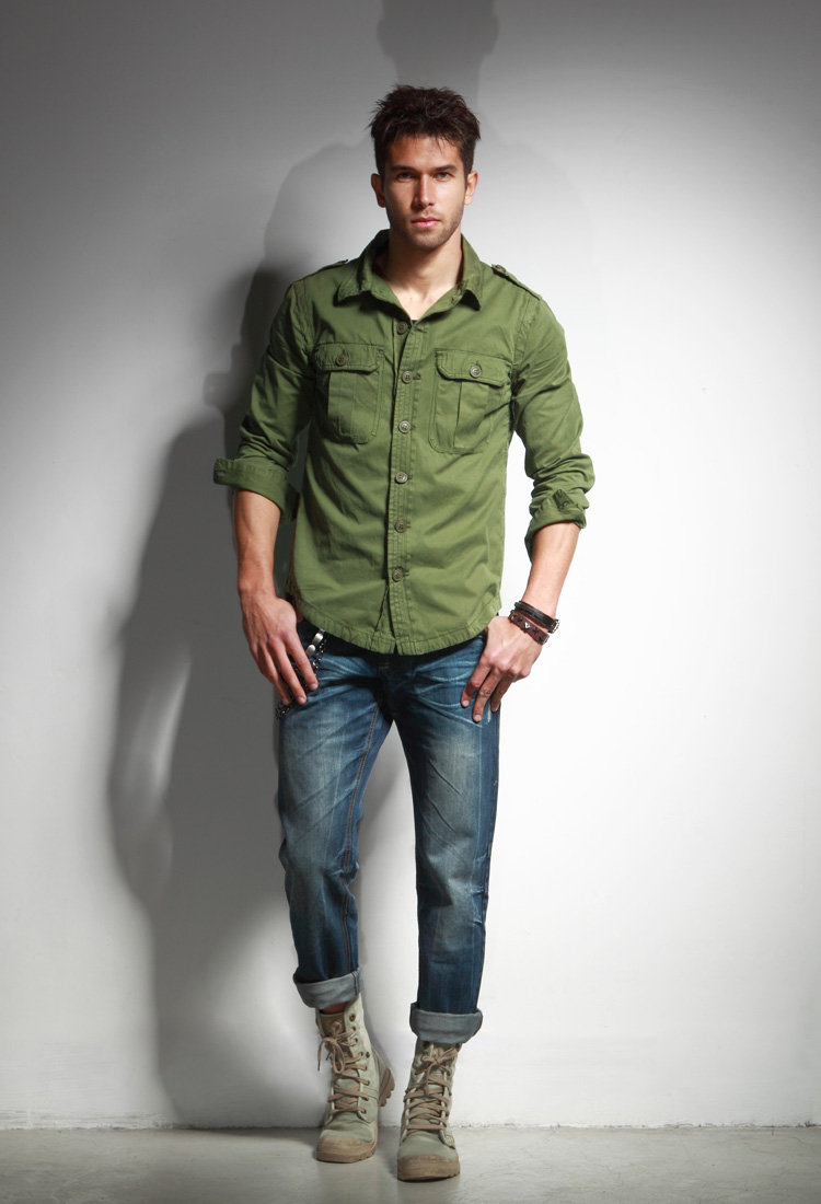 file man wearing green shirt jacket blue jeans and desert