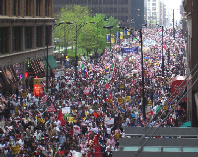 A rally on May Day 2006 in Chicago. The protests began in response to proposed legislation known as H.R. 4437, which would raise penalties for illegal immigration and classify undocumented immigrants and anyone who helped them enter or remain in the US as felons. May 1 2006 Rally in Chicago.jpg