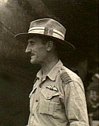 Informal head-and-torso profile of moustachioed man in light-coloured uniform and slouch hat