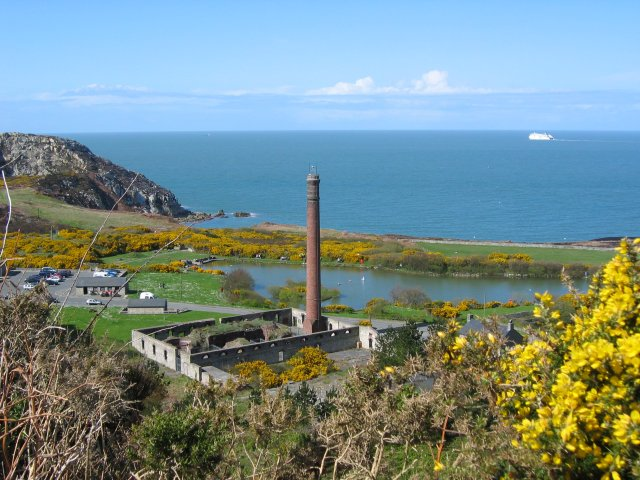 Quarry (Breakwater Country Park) from Pen Gwaith. The kiln house and chimney of the old quarry. In the left foreground is the visitor centre and shop of the Country Park.