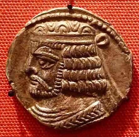 Silver coins of Vologases I Iran, Parthian, AD 55-6 In the Zoroastrian tradition holy texts were scattered as a result of Alexander of Macedon's conquest of the Persian Empire in 330 BC. These were gatheres together by Vologases I (Wa