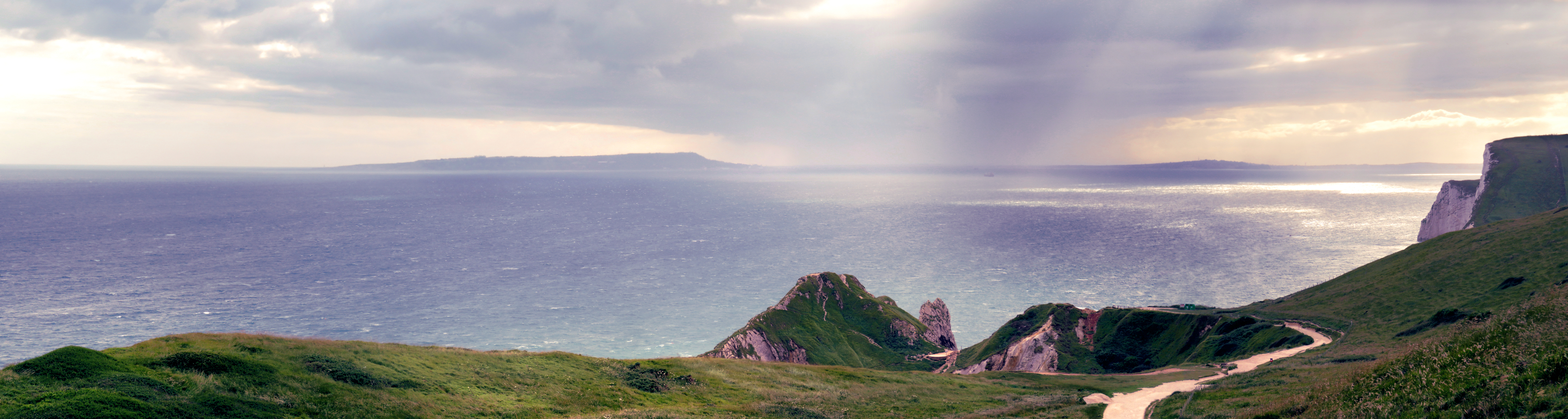 View from clifs above Durdle Door at dusk with rain approaching over the sea. & Durdle Door - Wikipedia