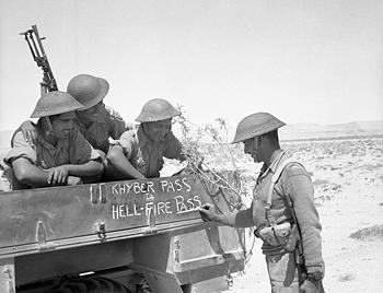 "Soldiers of the 4th Indian Division decorate the side of their lorry ""Khyber Pass to Hell-Fire Pass"" during Operation Battleaxe in June 1941. IWM-E-003660-4700-32.jpg"