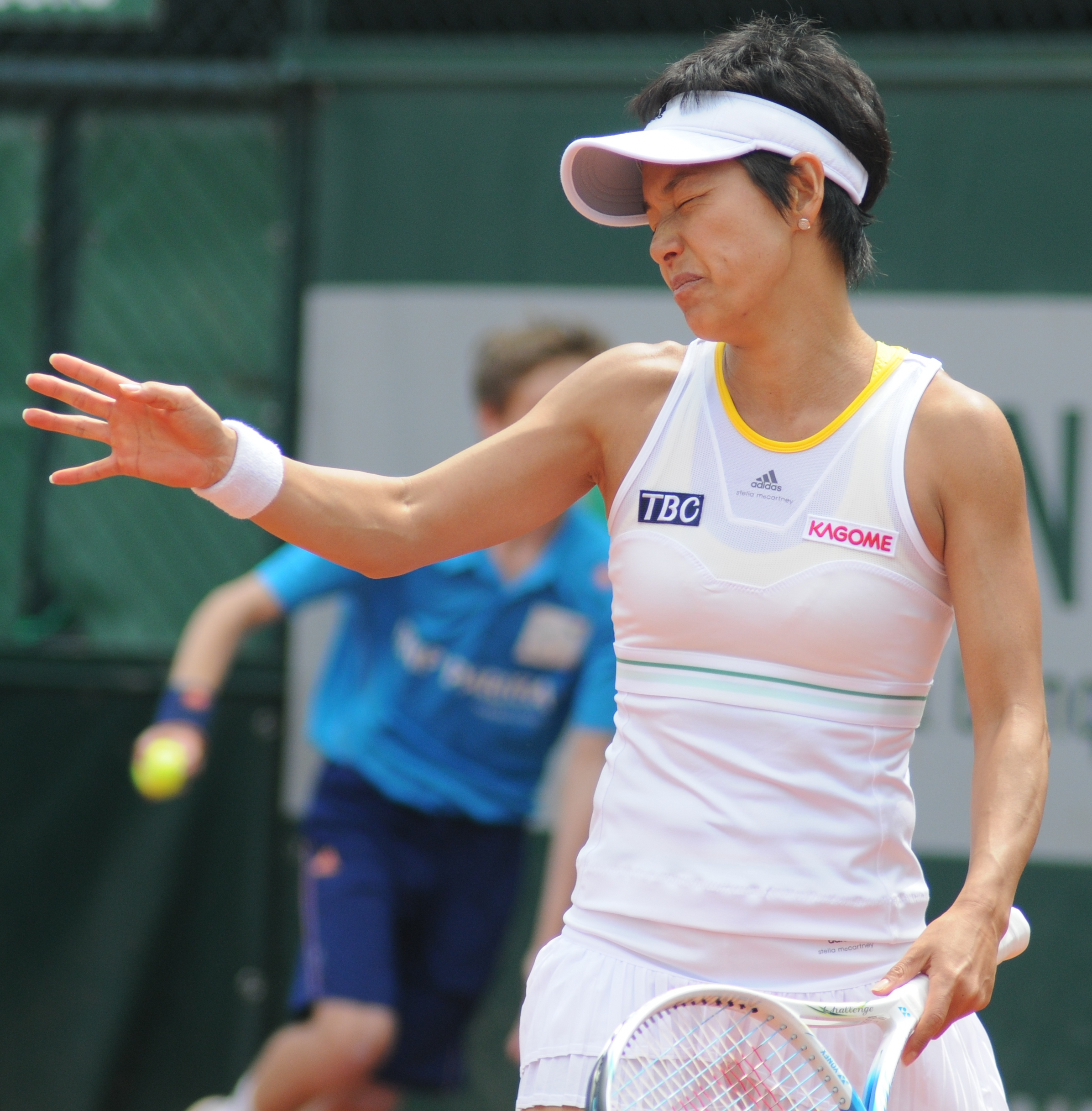 Kimiko Date Krumm of Japan celebrates a point against Monica Miculescu ...