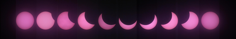 Déroulé de l'éclipse solaire du 20 mars 2015 vue depuis le Haut-Doubs - Labergement Sainte-Marie (25). Assemblage de 10 images prises au 400mm. Couleur rouge due au filtre mylar.