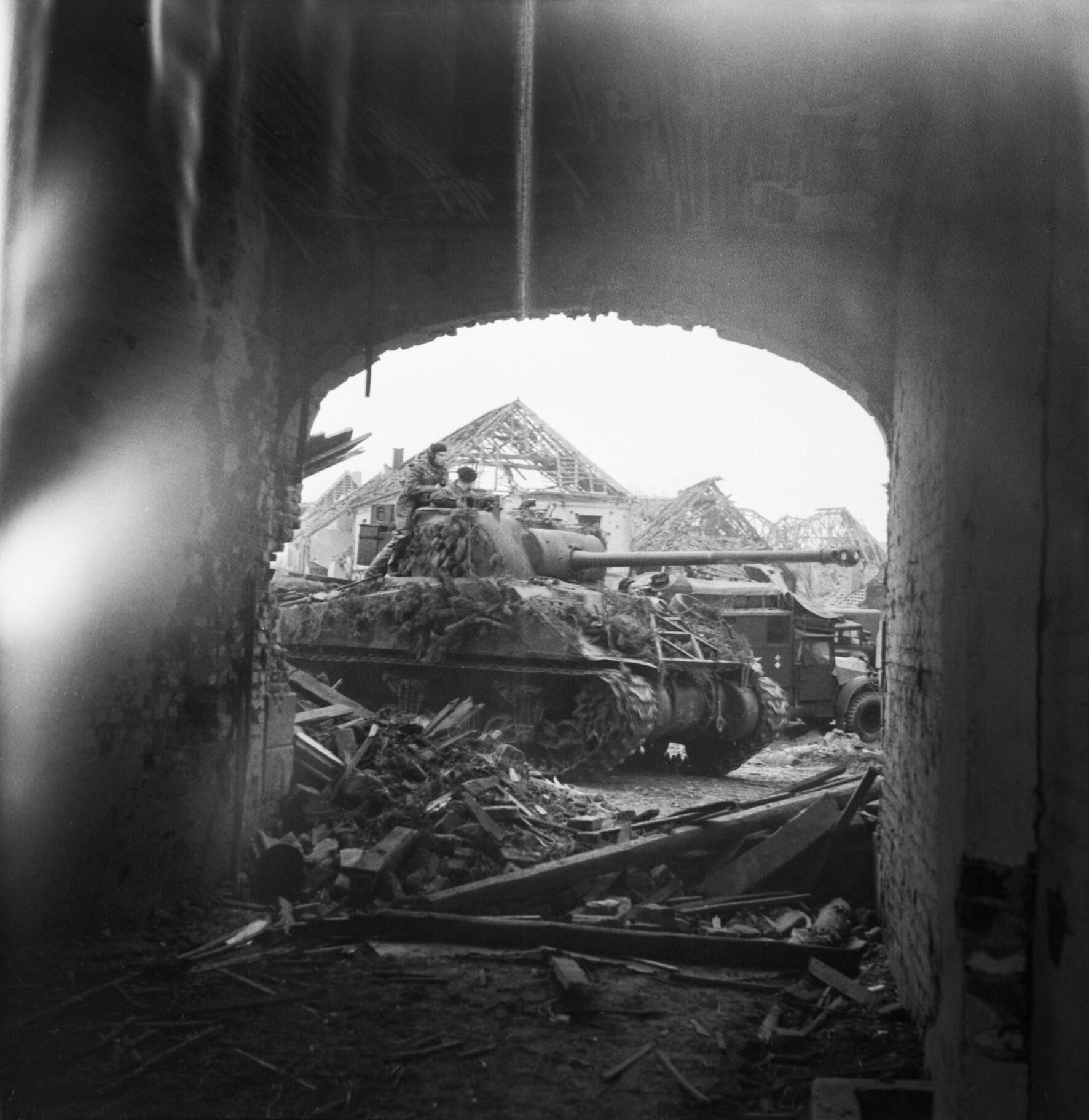Sherman Firefly tank seen through an archway