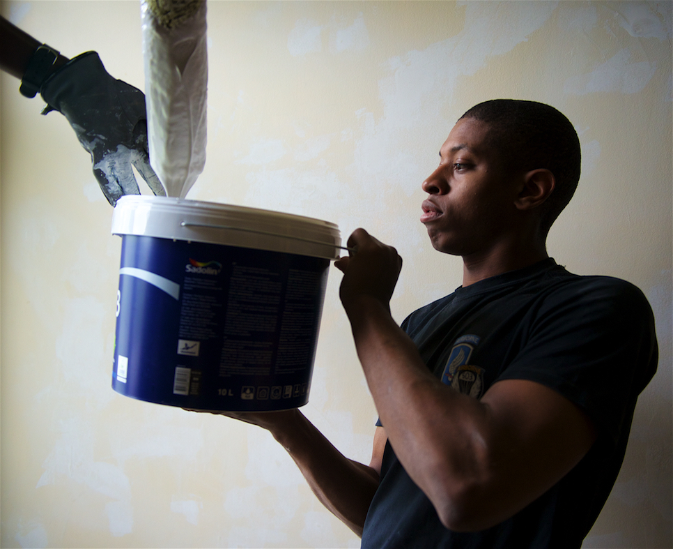 US Soldiers pay-it-forward, help renovate Latvian orphanage 150712-A-JK968-005.jpg English: Pfc. Michael White, a Lexington, Ky., native, with