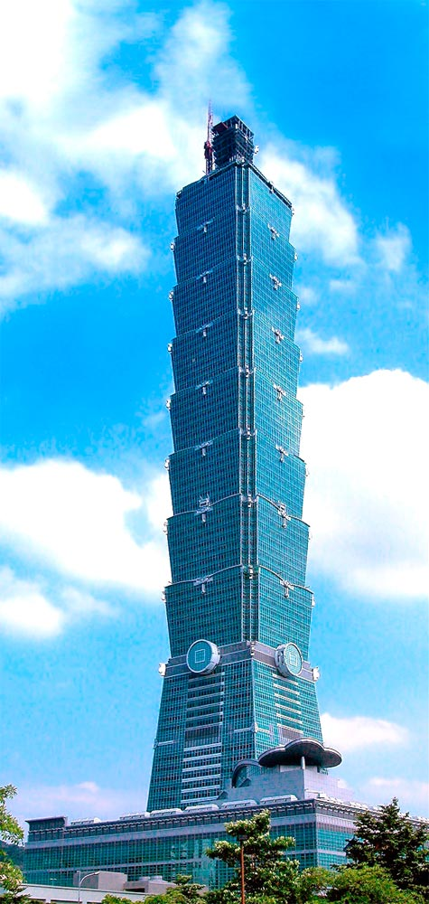 Photo of a high tower against a blue sky.