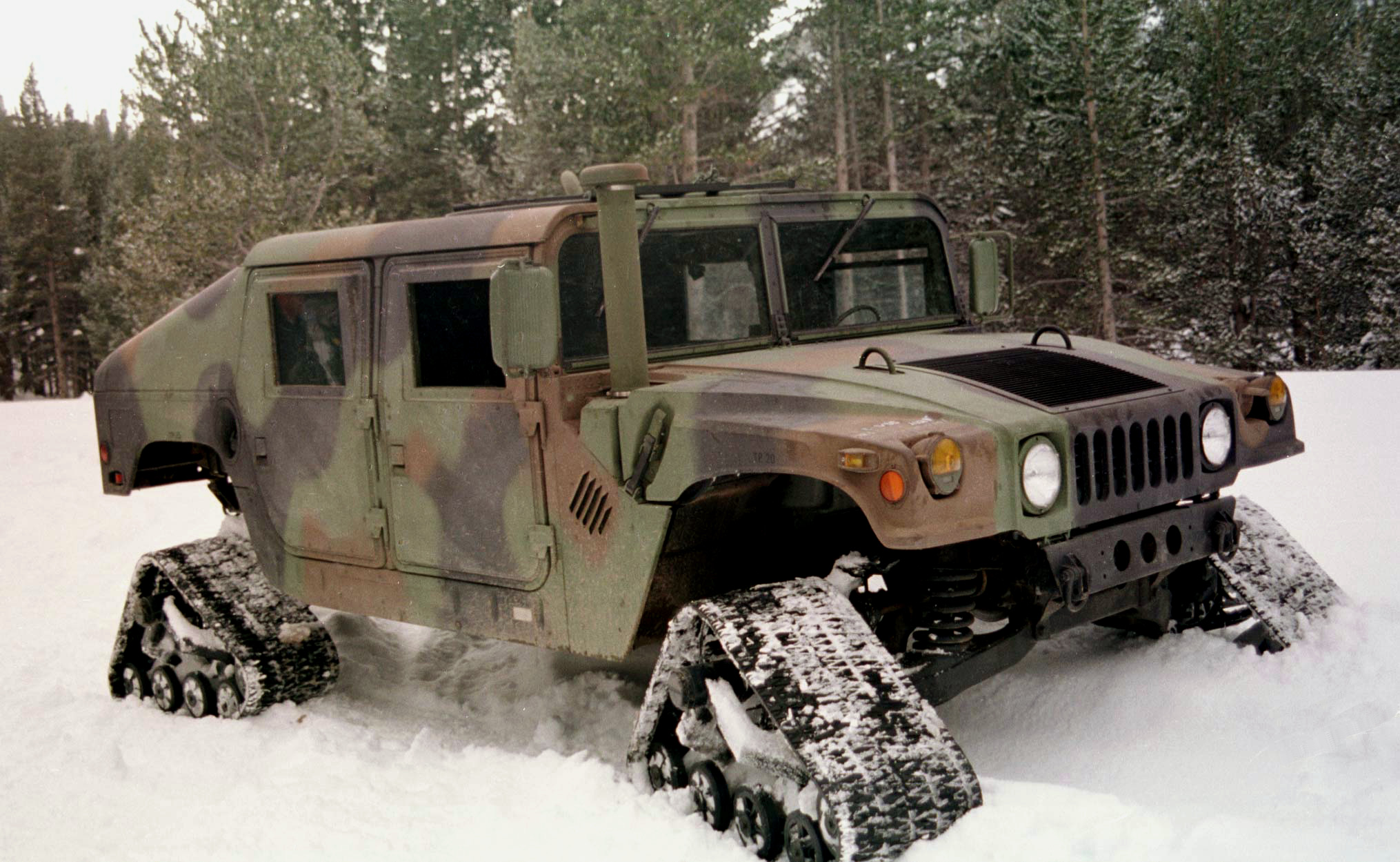 http://upload.wikimedia.org/wikipedia/commons/e/eb/Humvee_equipped_with_four_snow_treads.jpg