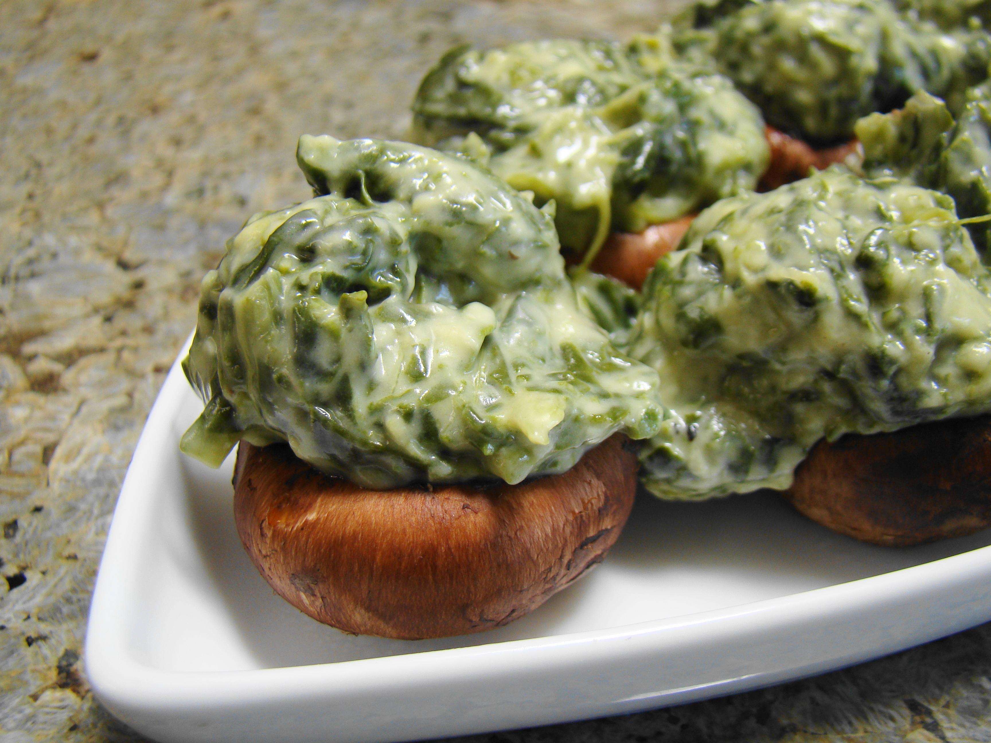 Description Kremed Spinach Stuffed Mushrooms on white serving dish.jpg