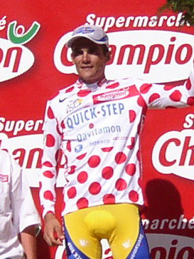 Richard Virenque pictured at the 2003 Tour de France wearing the polka dot jersey. He won the mountains classification a record seven times. Richard Virenque - Tour de France 2003 - Alpe d'Huez (cropped).jpg