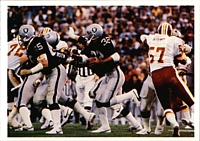 Allen (center) led the Raiders to a championship in Super Bowl XVIII and earned MVP honors as he rushed for a record of 191 yards, including a memorable 74-yard touchdown run.[5]