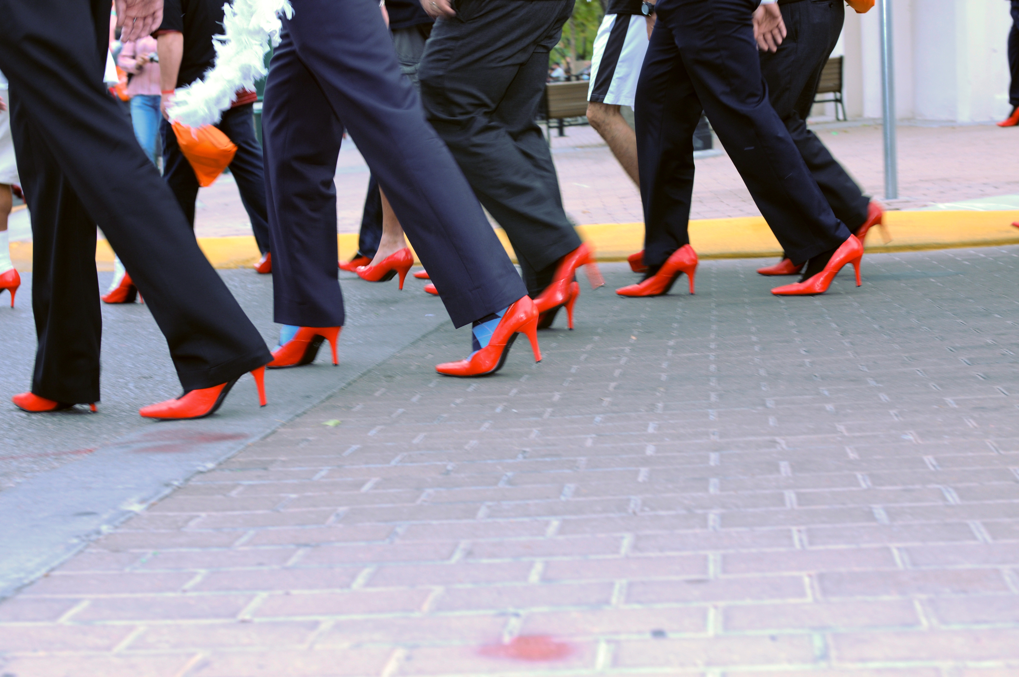 Men walk in heels for Walk a Mile in Her Shoes event to raise awareness of violence against women