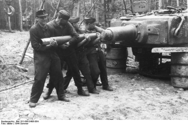 "Men of 9. SS-schwere Panzer-Kompanie ""Totenkopf"" changing a gun barrel"