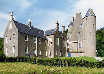 A castle in Scotland featuring tall walls and turrets