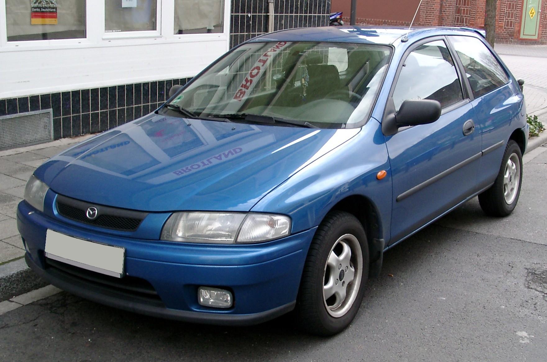 Mazda 323 —
