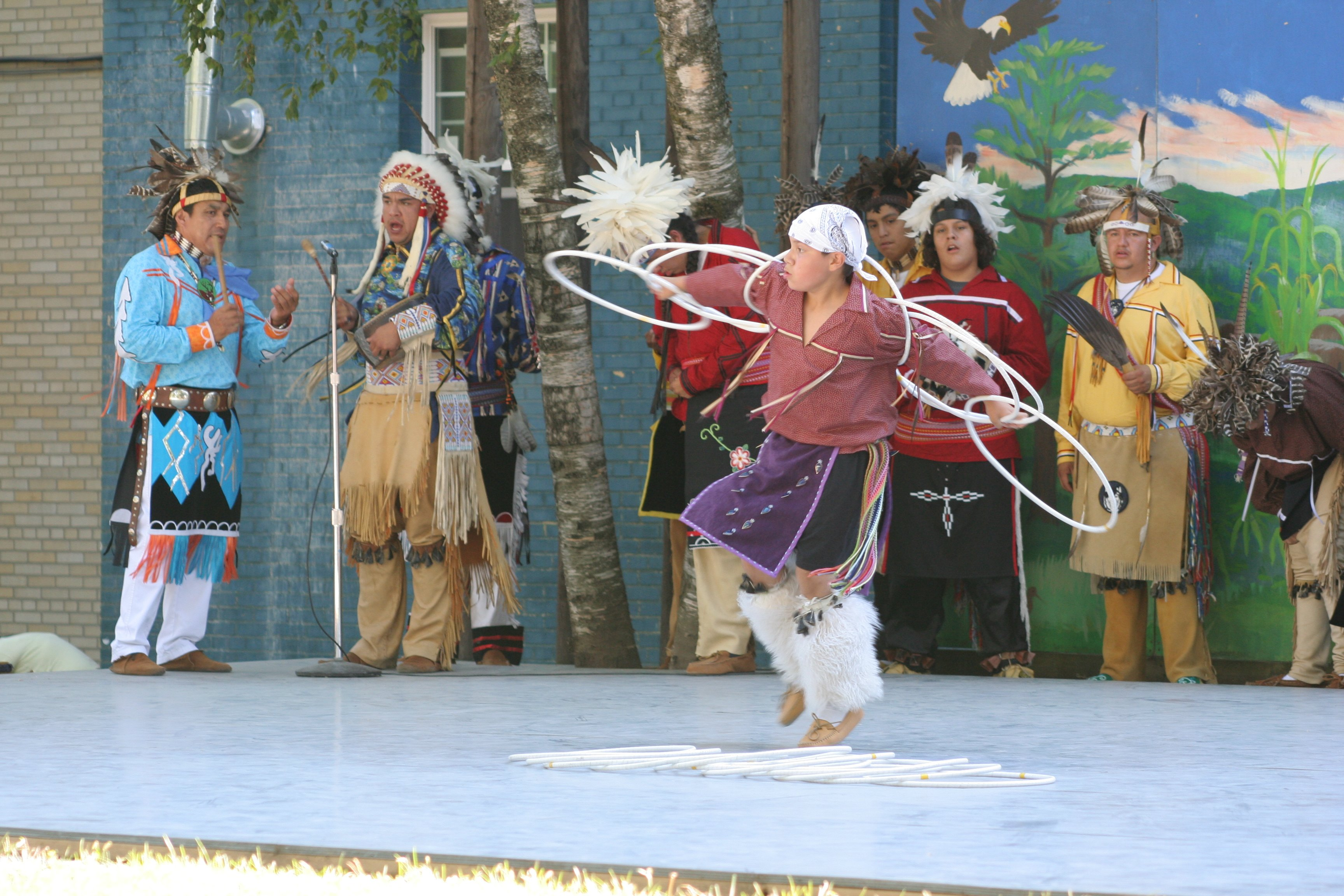 Iroquois performing a traditional dance at a cultural fair.