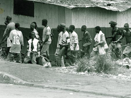 NPFL fighters search for ULIMO militants in Monrovia. National Patriotic Liberation Front fighters in Monrovia 1996.png